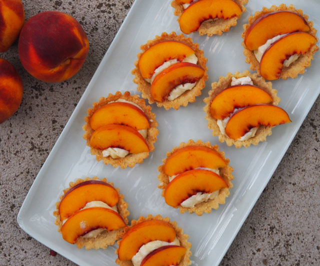 The easiest peach, white chocolate and macadamia tartlets
